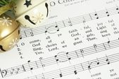 Music sheet and jingle bells. — Stock Photo