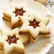 Christmas cookies on plate and Christmas ornaments. — Stock Photo #27278967
