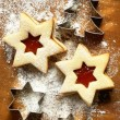 Stock Photo: Christmas cookies with jam and cookie cutters