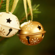 Jingle bells on Christmas tree with copy space. — Stock Photo