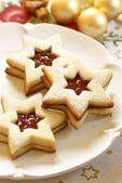 Christmas cookies on plate and Christmas ornaments. — Stock Photo