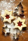Christmas cookies with jam and cookie cutters — Stock Photo