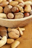 Wooden bowl with nuts — Stock Photo