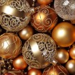 Golden Christmas ornaments background. — Stock Photo #27338819