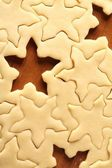 Pastry for Christmas cookies and snowflake shapes. — Stock Photo