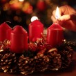 Hand with a match and first advent candle. — Stockfoto