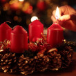 Hand with a match and first advent candle. — Foto de Stock
