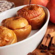 Baked apples in white bowl and ingredients. — Stock Photo #27418349