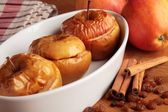 Baked apples in white bowl and ingredients. — Stock Photo