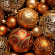 Golden Christmas ornaments background. — Stock fotografie