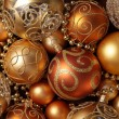 Golden Christmas ornaments background. — Стоковое фото