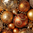 Golden Christmas ornaments background. — Foto de Stock