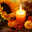 Stock Photo: Arrangement of sunflower, candle and autumn decorations
