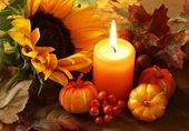 Arrangement of sunflower, candle and autumn decorations — Stock Photo