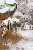 Whisk, cookie cutters, baking tins, icing tubes and cookie cups — Stock Photo