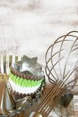 Whisk, cookie cutters, baking tins and cookie cups — Stock Photo
