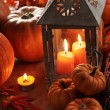 Lantern with burning candles and pumpkins — Photo