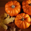 Top view of autumn colored leaves and little pumpkins — Stock Photo #28226315