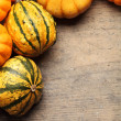 Pumpkins frame on wooden table — Stock Photo