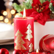 Candles and ornaments on holiday table — Foto Stock