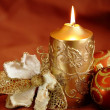 Christmas still life - candle, decorative flower and ornaments — Stock Photo