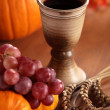 Chalice with wine, grapes, corn and pumpkins — Stock Photo