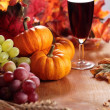 Stock Photo: Glass with wine, grapes, corn and pumpkins
