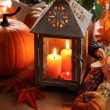 Lantern with candles, pumpkins and autumn decorations. — Stock Photo