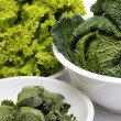 Lettuce, savoy cabbage and frozen spinach — Stock Photo