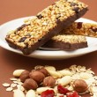 Granola bar, almonds, nuts, dry cranberries, oat flakes — Stock Photo
