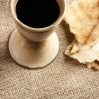 Chalice with wine and piece of bread — Stock Photo #28639579