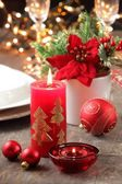 Candles and ornaments on holiday table — Stock Photo