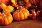 Pumpkins and autumn decorations — Stock Photo