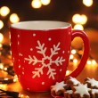 Mug with hot drink and Christmas cookies — Stock Photo #29008379