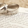 Two rings on open Bible - 1. Corinthians chapter 13. — Stock Photo #29360081