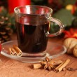 Hot wine with spices and christmas decorations  — Stock Photo
