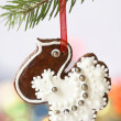 Christmas homemade gingerbread decoration on a tree — Stock Photo #29362041