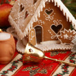 Gingerbread house and Christmas decorations — Stock Photo