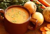 Vegetable soup in pot and fresh food ingredients — Stock Photo