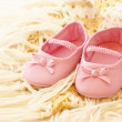 Baby pink shoes on blanket — Stock Photo #31958175