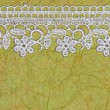 Stock Photo: Green paper and lace