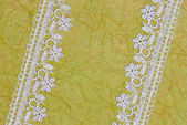 Green paper and lace. background — Stock Photo