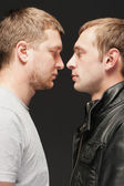 Two guys looking intensely into each others eyes — Foto de Stock