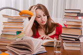 Tired student having a lot to read. — Stock Photo