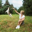 Girl play with dog. — Stock Photo