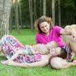 Young Family with dog relaxing In Park — Stock Photo