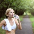 Young healthy woman drinks water — Stock Photo