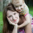 Mother And Daughter playing in the park — Stock Photo #26720127