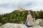 Girl looking at Pena Palace in Portugal. — Stock Photo