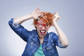 Young girl screams and cuts her hair — Stock Photo